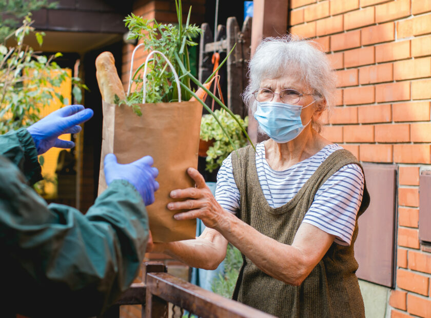 grocery delivery to senior woman during pandemic