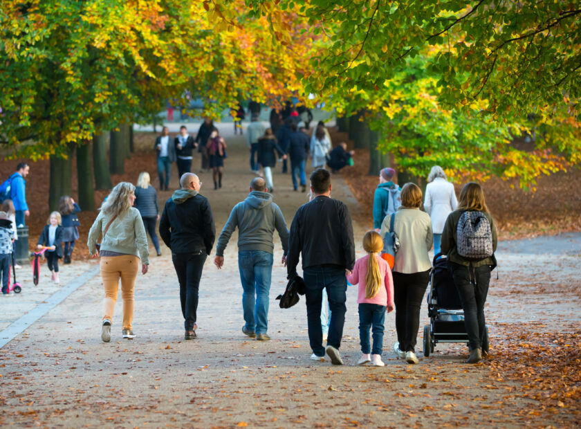 LONDON, UK - OCTOBER 31, 2015: Autumn in London park, people and families walking and enjoying the weather